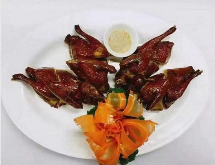 BBQ pigeons on a plate